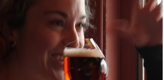 Woman smiling with beer in her hand