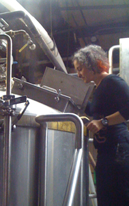 Mirella Amato peeking into a mash tun