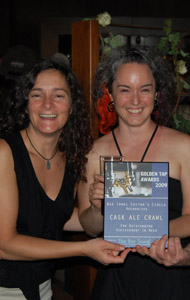 Maz Brereton and Mirella Amato of Cask! accepting a Golden Tap award for the Cask Ale Crawl