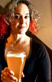 Photo of Mirella Amato holding a pint